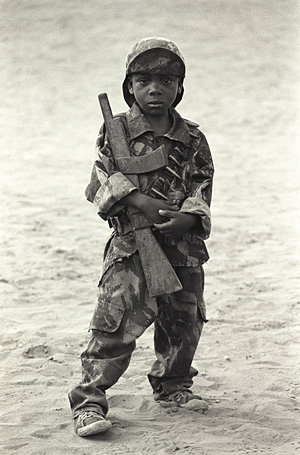 © Jean-Pierre Laffont / Sygma / Courtesy Visa Pour l'Image Child soldier in Angola, 1975. This picture made the poster for Visa pour l'Image 1996.