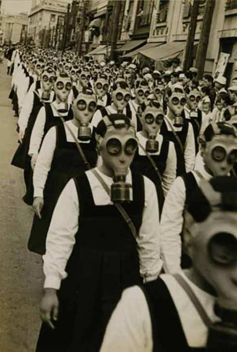 Gas Mask Parade, Tokyo, by Masao Horino 1936-1939 -from oldpicsarchive.com
